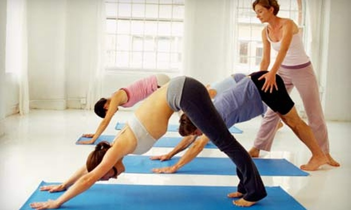 Power Yoga Chicago - DePaul: Eight or 12 Hot-Yoga Classes with Mat Rental at Power Yoga Chicago