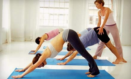 8 Hot-Yoga Classes (a $120 value) & Mat rental (a $16 value; a $136 total value) - Power Yoga Chicago in Chicago