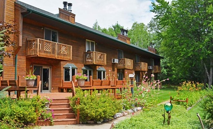 groupon daily deal - 1- or 2-Night Stay for Two in the AuSable, East Bay, or Cedar Trail Room at Springbrook Inn near Houghton Lake, MI