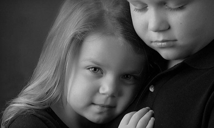 Phil Hyman Photography - Augusta Street Area: $99 for a Portrait Package with a Custom Portrait Session and a $200 Photo Credit at Phil Hyman Photography (67% Off)