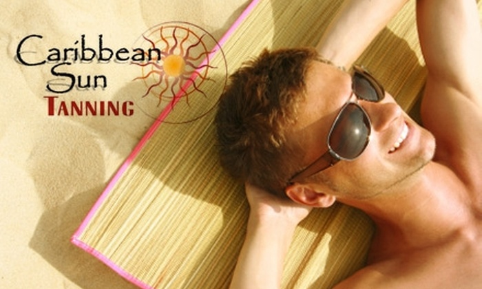 Caribbean Sun  - Multiple Locations: $10 for One Month of Unlimited Bed Tanning or One Spray Tan at Caribbean Sun (Up to $40 Value)