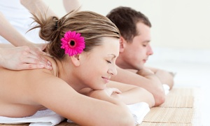 Urban Bliss Day Spa: Couples Therapeutic Massage with Aromatherapy, or Facial with Massage at Urban Bliss Day Spa (Up to 49% Off)