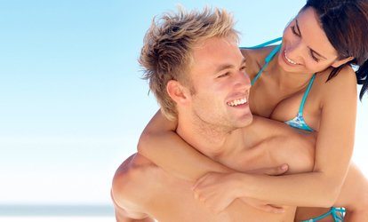 image for Heated Spray Tans or One-Month Unlimited <strong>Tanning</strong> Package (Up to 78% Off)