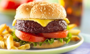 American Steamed Cheeseburgers: Cheeseburgers for 2 or 4 with Chips, Cookies, & Canned Drinks at American Steamed Cheeseburgers (Up to 52% Off)