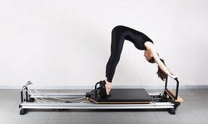 Pilates Plus Restoration Studio: Four or Eight Small-Group Pilates Reformer Sessions at Pilates Plus Restoration Studio (Up to 46% Off)
