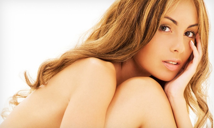 Totally Tan - Ramsey: Two or Four Mystic Tan Spray Tans or Three or Six Sessions in UV Bed at Totally Tan (Up to 75% Off)