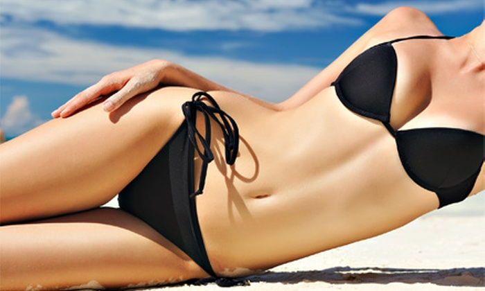 Tailored Spray Tans or One Month of Orbit Bed Tanning from At the Beach Tanning (Up to 61% Off). Six Options Available.
