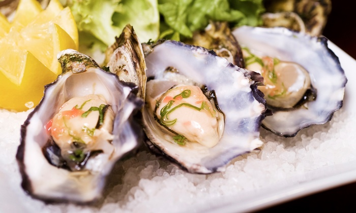 Eats on Lex - Upper East Side: $43 for Two Dozen East Coast Blue Point Oysters and Two Martinis at Eats on Lex ($102 Value)