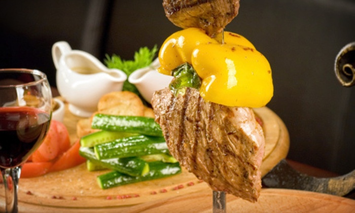 Chapada Chophouse and Churrascaria - Wichita: All-You-Can-Eat Brazilian-Steakhouse Meal for Two or Four at Chapada Chophouse and Churrascaria (Up to 51% Off)
