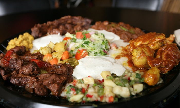 GoJo Ethiopian Cuisine - Eastown: Ethiopian Sampler Tray for Two or Four at GoJo Ethiopian Cuisine (Up to 40% Off)