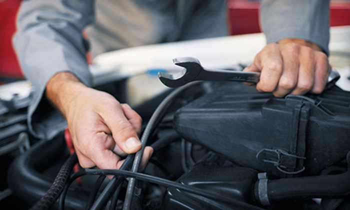 Central Car Care - Phoenix: $25 for an Oil-Change Package with a Tire Rotation and 21-Point Inspection at Central Car Care ($95.97 Value)
