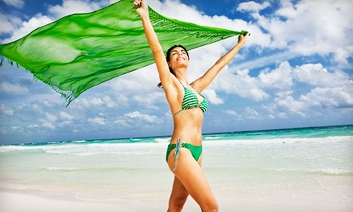 Zoom Tan - Multiple Locations: $49 for One Month of Unlimited Spray and UV Tanning at Zoom Tan (Up to $99 Value)