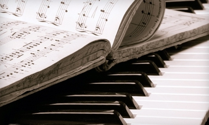 Middle C Music - Washington: $59 for Two Guitar or Piano Lessons + a BeginnersMethod Book at Middle C Music ($114.99 Value)