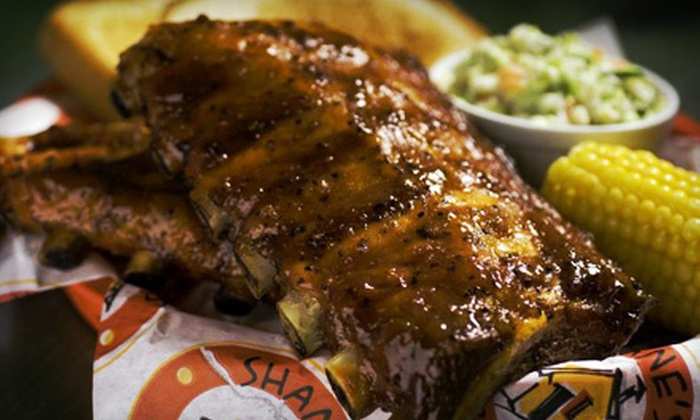 Shane's Rib Shack - Whispering Pines: Meal with Sides and Drinks for Four or $12 for $25 Worth of Barbecue Fare at Shane's Rib Shack in Snellville
