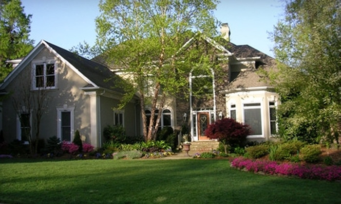 Buck's Lawn Service  - Raleigh / Durham: $150 for a High-Pressure Washing from Buck's Lawn Service ($300 Value)