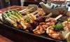 Raku - Raku - Atlanta: $18 for a Winter Yakitori Tasting Dinner with Drinks for Two or More at Raku ($35.35 Value)