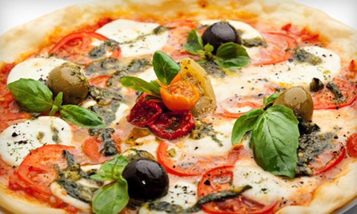 Pisa Pizzeria - Vanier: $12 for a Large Three-Topping Pizza, Two Cans of Pop, and Parmesan Garlic Bites at Pisa Pizzeria ($24.18 Value)