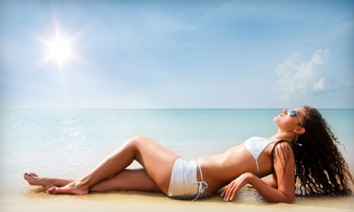 Jamaica Tan - Lawrence: $25 for 10 Level-Two Tanning Sessions ($77.50 Value) or $25 for Three Spray-Tanning Sessions ($60 Value) at Jamaica Tan