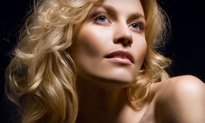 Studio 229 - Capitol Hill: $95 for a Spa Package with Facial, Haircut, Conditioning Treatment, and Eyebrow Wax at Studio 229 (Up to $200 Value)