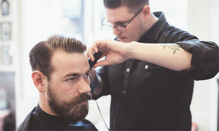 Euro Cuts Barbershop - Central Business District: A Men's Haircut with Shampoo and Style from Euro Cuts (52% Off)
