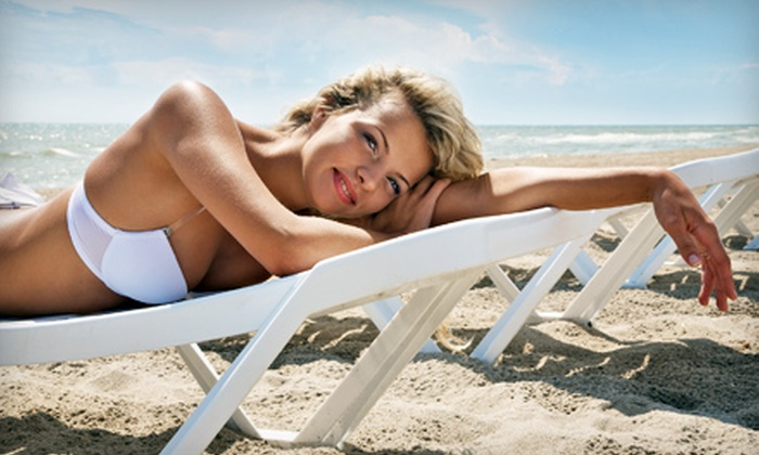 The Cat's Meow - South Central: $35 for Two Spray-Tanning Sessions at The Cat's Meow ($70 Value)