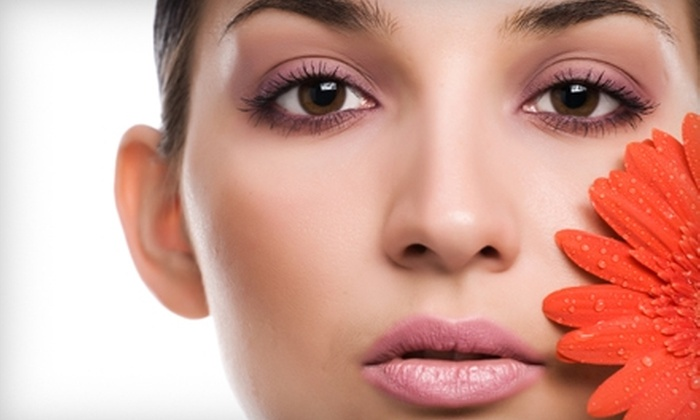 Uptown Hair Studio and Day Spa - Englewood: $10 for Two Facial-Area Waxes (Up to $30 Value) or $25 for a Make-Up Session ($50 Value) at Uptown Hair Studio and Day Spa