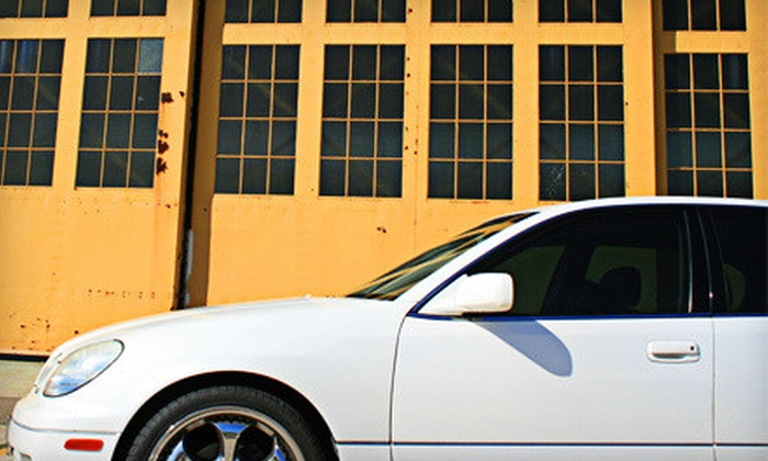 Precision Window Tint - Highland Park: Auto-Glass Tinting or Residential or Commercial Tinting from Precision Window Tint (Up to 55% Off). Four Options Available.