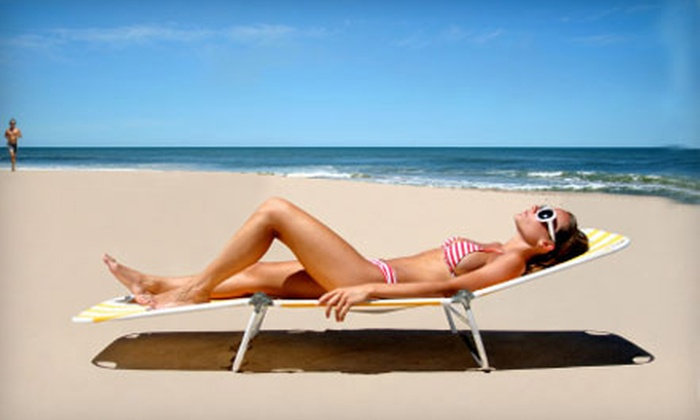 Solar 51 - Multiple Locations: $25 for Three Spray Tans or One Month of Bed Tanning with Upgrades at Solar 51 (Up to $89.30 Value)