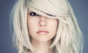 Salon Modello: Brazilian Blowout or Women's Haircut from HoMing at Salon Modello (Up to 50% Off)