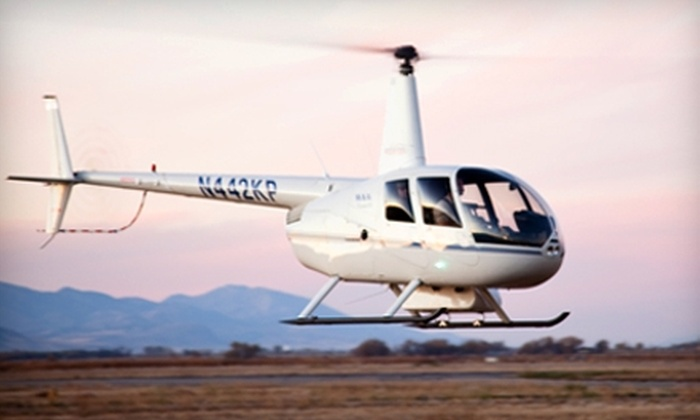 Mountain Ridge Helicopters - Logan: $105 for a Helicopter Ride for Two with One Photograph and Two T-Shirts from Mountain Ridge Helicopters (Up to $253 Value)