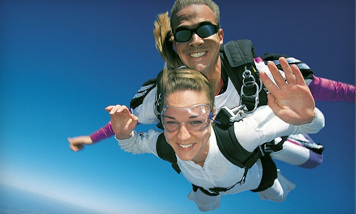 Midwest Freefall Sport Parachute Club - Ray: $143 for a Tandem Skydiving Jump from 14,000 Feet from Midwest Freefall Sport Parachute Club in Ray ($239 Value)
