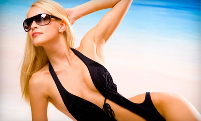 Tropic Image Tan - Grayslake: Two Spray Tans or One Month of Unlimited Tanning at Tropic Image Tan in Grayslake