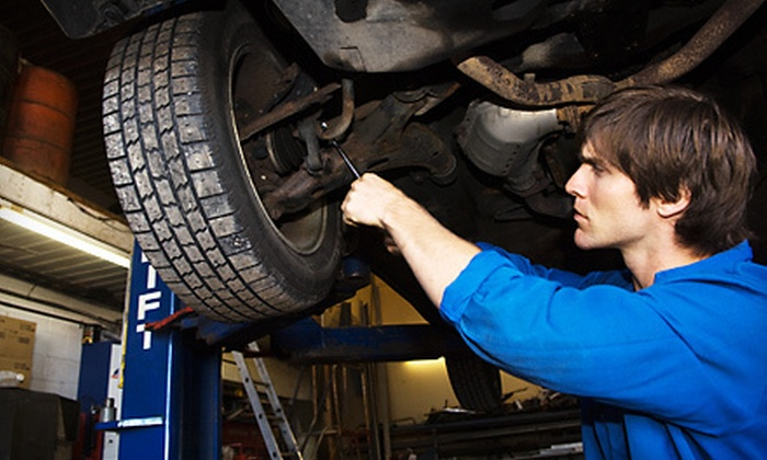 Acme Muffler LLC - Southside: Oil Change with Optional Tire Rotation at Acme Muffler LLC (Up to 59% Off)
