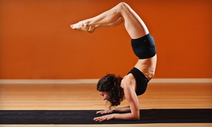 Downward Dog Yoga & Fitness - Coralville: $25 for Five Yoga, Pilates, or Boot Camp Classes ($55 Value) or $25 for Personal Training Session ($50 Value) at Downward Dog Yoga & Fitness