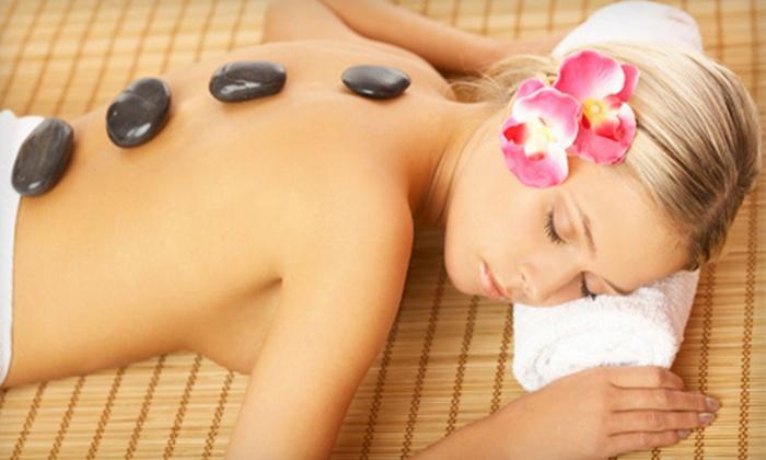 Simplicity Massage & Reflexology - Okemos: Hot-Stone or Reflexology Massages at Simplicity Massage & Reflexology (Up to 55% Off). Three Options Available.