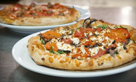 $30 Groupon for 2 or More Diners - Toss in Baltimore