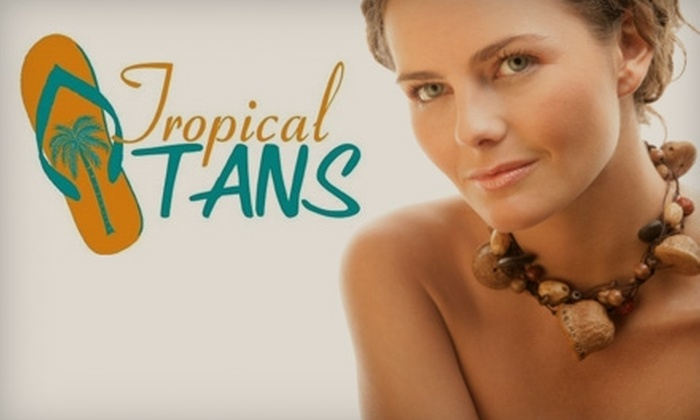 Tropical Tans - Parkway: $23 for One Month of Unlimited Tanning or Two Airbrush Tans at Tropical Tans (Up to $65.58 Value)