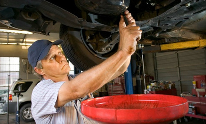 Quick Lane Tire & Auto Center - Devon - Walnut Beach: $25 for an Oil Change, Tire Rotation, Inspection, and Check Engine Light Diagnostic at Quick Lane Tire & Auto Center in Milford ($154 Value)