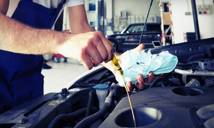 Kip Killmon's Tysons Ford - Old Courthouse: Premium Oil Change with Tire Rotation or Synthetic Oil Change at Kip Killmon's Tysons Ford (Up to 65% Off)