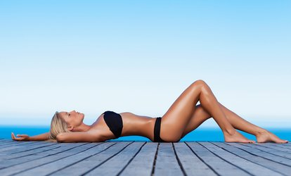 Spray Tanning: One ($15), Two ($29) or Four Sessions ($49) at Liquid Hedz (Up to $140 Value)