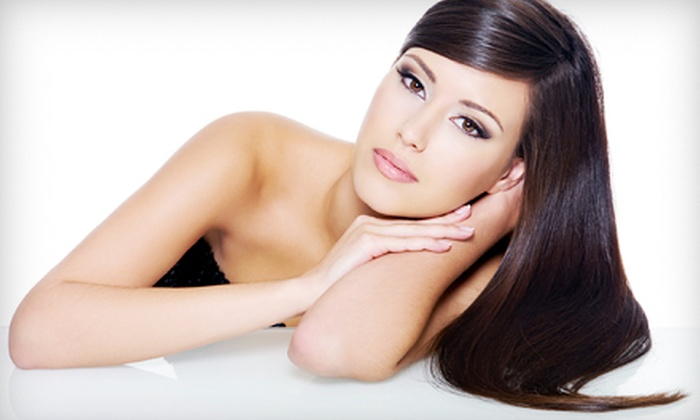 DJ's Tanning Salon - Timberlea: Haircut Package with Optional Full or Partial Highlights and Flat Iron at DJ's Tanning Salon (Up to 63% Off)