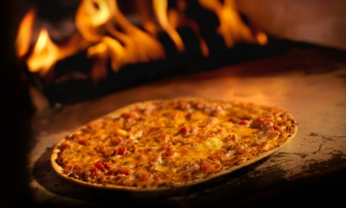 Rival's Pizza - Toledo: $10 for $20 Worth of Specialty Pizzas, Subs, Tacos, and more at Rival's Pizza