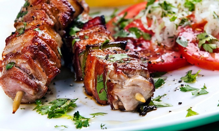 Suzani Restaurant - Suzani Restaurant: One Kebab with a Side and Drinks at Suzani Restaurant (44% Off)