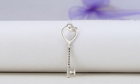 $10 for an Engraved-Key Pendant Necklace Plated in Sterling Silver from MonogramHub ($65 Value)