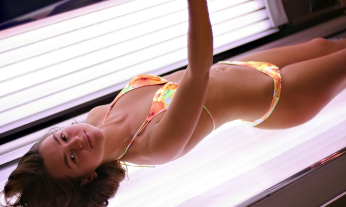 Sunsations Tanning Salon, LLC - Topeka: One Month of Unlimited Tanning or One Sunless Tan at Sunsations Tanning Salon (Up to 61% Off)