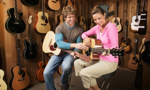 The Hughes Music Company: Two or Four 30-Minute Private Music Lessons for the Piano, Guitar, or Bass at The Hughes Music Company (Up to 60% Off)