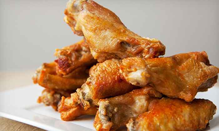 Chics N Wings - Tysons Central 123: Four Dozen Wings for Four or Two Groupons, Each Good for $20 of American Food at Chics N Wings