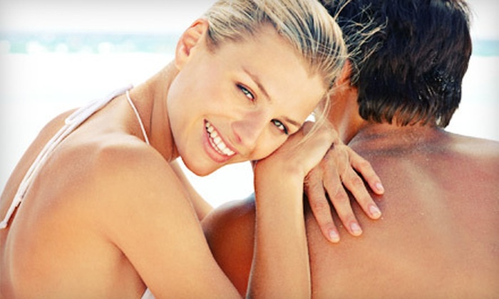 East Hampden Tanning Salon - Cherry Creek District: One or Three Spray Tans or One or Three Months of UV Tanning at East Hampden Tanning Salon in Aurora (Up to 79% Off)