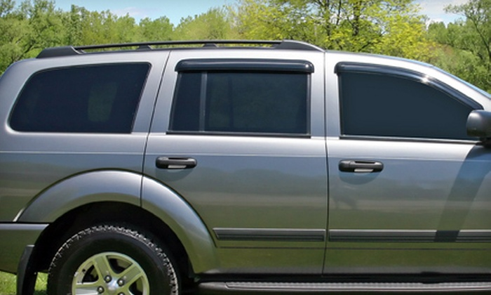 Aggressive Sounds Car Audio - Greensboro: Window Tinting for Two Front-Door Windows or Full Vehicle at Aggressive Sounds Car Audio in Greensboro (Up to 54% Off)