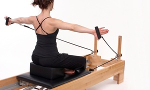 Pilates + Yoga Studio: 5 or 10 Reformer Pilates Classes at Pilates + Yoga Studio (Up to 59% Off)